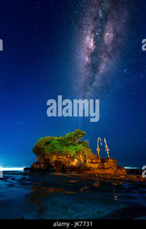 Milky way over Tanah Lot Temple at night in Bali, Indonesia.(Dark) - Stock Photo