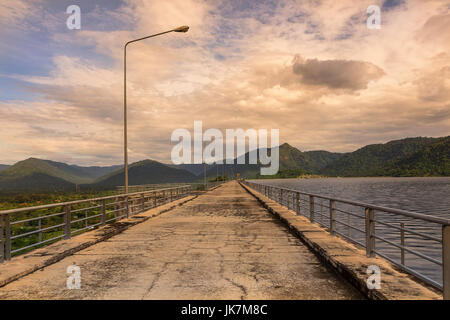 beautiful concrete dam and life in twilight time with reflection on dam road - Stock Photo