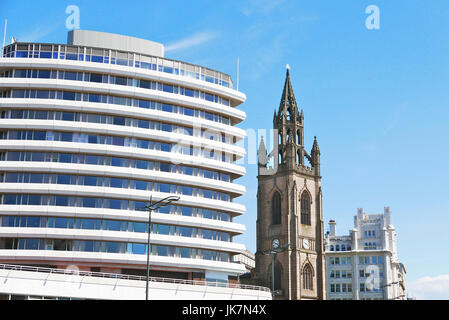The old and the new.Our Lady and St Nicholas Parish Church next to the Mercure Liverpool Atlantic Tower Hotel,Liverpool,UK - Stock Photo