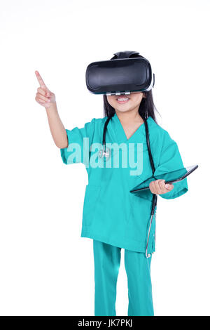 Asian Little Chinese Girl playing doctor with tablet and VR goggles in isolated white background - Stock Photo