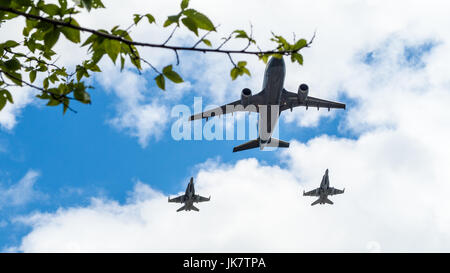 Airbus CC-150 Polaris and McDonnell Douglas CF-18 Hornet of Royal Canadian Air Force fly over Ottawa, Capital of - Stock Photo