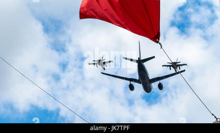 Airbus CC-150 Polaris and McDonnell Douglas CF-18 Hornet of Royal Canadian Air Force fly under the Canada Flag, - Stock Photo