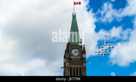 The Canadian Forces (CF) Snowbirds flypast the Peace Tower on the Parliament Hill to celebrate Canada Day, Ottawa, - Stock Photo