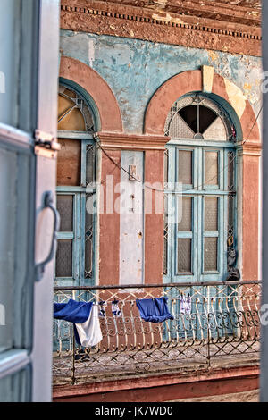 A view from one apartment window to another inn Havana, Cuba. - Stock Photo