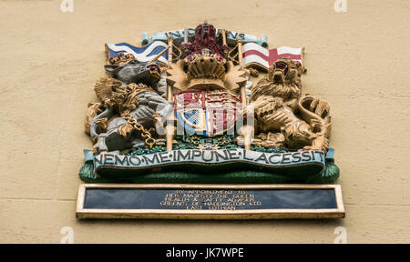 Nemo me impune lacessit Scottish Royal Arms above doorway, appointment to Her Majesty Queen Health and Safety Advisor - Stock Photo
