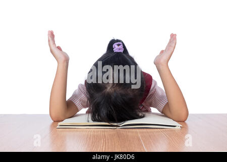 Frustrated Asian Chinese little girl with head down on the table in isolated white background - Stock Photo