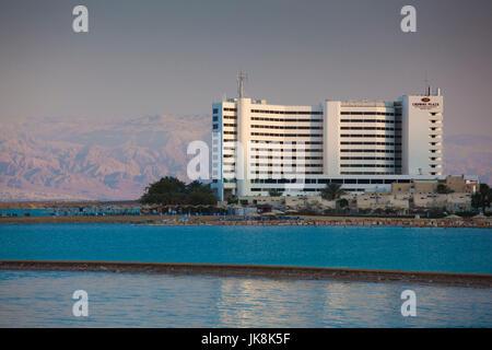 Israel, Dead Sea, Ein Bokek, Dead Sea resort hotels, dusk - Stock Photo