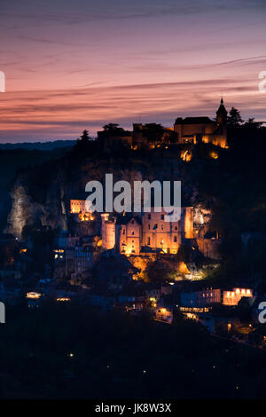 France, Midi-Pyrenees Region, Lot Department, Rocamadour, elevated town view, dusk - Stock Photo