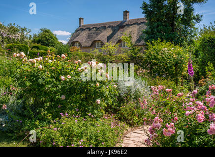 Typical 'English Country Garden' with country cottage - Stock Photo