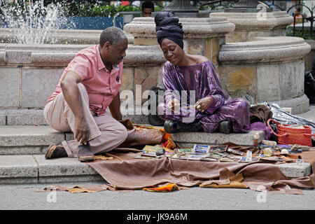 A psychic tarot card reader givers a reading in Union Square Park in Manhattan, New York City - Stock Photo