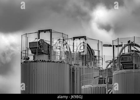 Black and white image of Industrial architecture at a china clay drying plant at Par beach, Cornwall. - Stock Photo