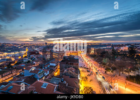 Evening in Porto, second largest city in Portugal. Aerial view from bell tower of Clerigos Church - Stock Photo
