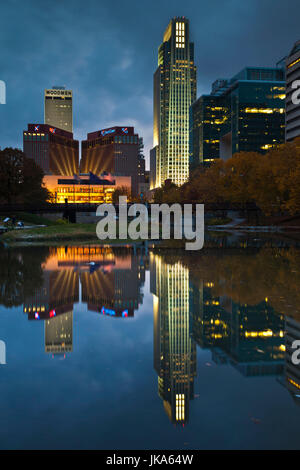 USA, Nebraska, Omaha, Gene Leahy Mall, skyine, dusk - Stock Photo