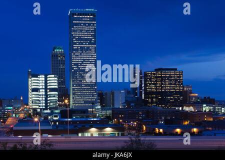 USA, Oklahoma, Tulsa, city skyline from highway I-244, dusk - Stock Photo