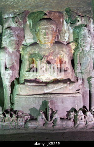 Statue of Buddha inside one of many ancient rock carved Buddhist cave temples at Ajanta Caves near Aurangabad, India. - Stock Photo