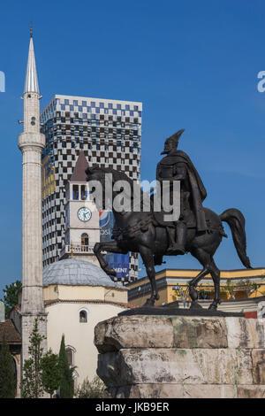 Albania, Tirana, Skanderbeg Square, Ethem Bey Mosque and statue of Skanderbeg - Stock Photo