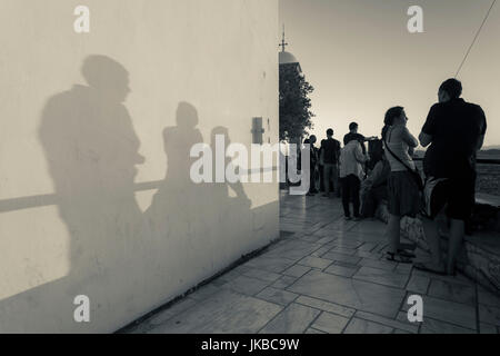 Greece, Central Greece Region, Athens, Lycabettus Hill, visitors at sunset - Stock Photo