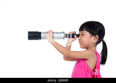 Asian Chinese little girl looking through a telescope in isolated white background - Stock Photo