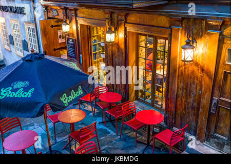 Quebec City, Canada - May 31, 2017: Restaurant with Grolsch sign and red chairs outside during blue hour by lower - Stock Photo