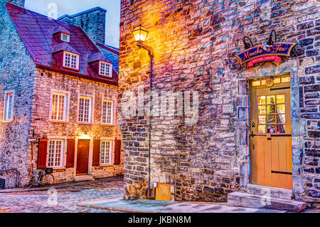 Quebec City, Canada - May 31, 2017: Colorful stone buildings on street during twilight in lower old town with Mouche - Stock Photo