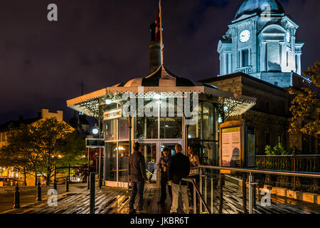 Quebec City, Canada - May 31, 2017: Old town view of people on dufferin terrace at night with illuminated Funiculaire - Stock Photo
