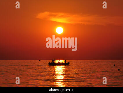 human figures on a boat at  sunsetkassandra - Stock Photo