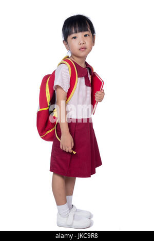 Asian Little Chinese girl in school uniform with school bag in isolated white background - Stock Photo