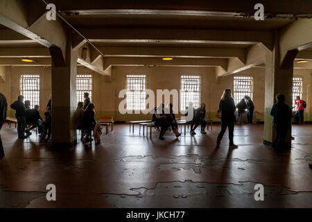 Tourists in prison lunch room at Alcatraz penitentiary, San Francisco, California, USA - Stock Photo
