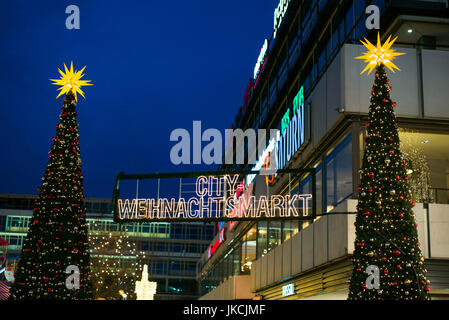 Germany, Berlin, Charlottenburg, Kurfurstendam, Europa Center, City Christmas market, dusk - Stock Photo