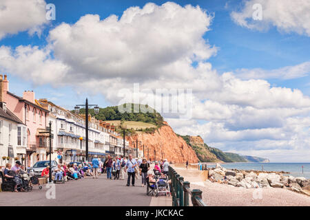 3 July 2017: Sidmouth, Dorset, England, UK - Visitors strolling on the promenade on a sunny summer day with blue - Stock Photo