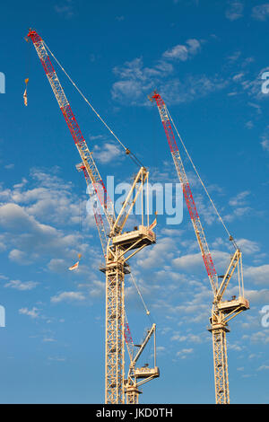 Australia, Western Australia, Perth, construction cranes, downtown, sunset - Stock Photo