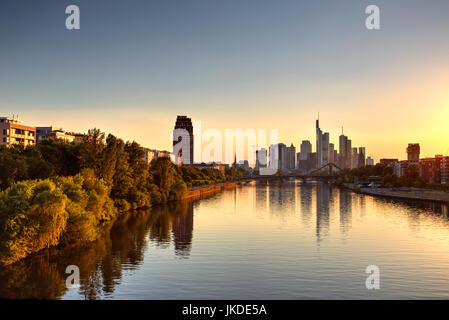 Frankfurt skyscrapers reflected on Main River and the golden hour, Germany - Stock Photo