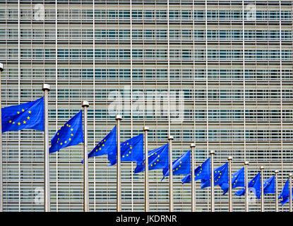 Brussels, Belgium. European Commission Berlaymont building - EU flags flying - Stock Photo