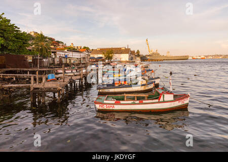 Fishing boats and Cuban navy military ship in Casa Blanca, Havana, Cuba - Stock Photo