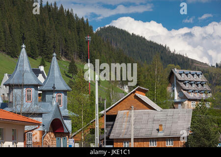 Romania, Bucovina Region, Rodna Mountains National Park, Sesuri, ski resort town, town Orthodox church - Stock Photo