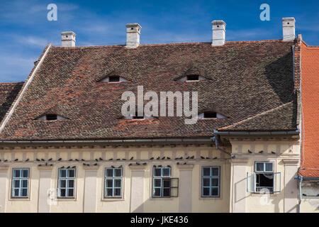 Romania, Transylvania, Sibiu,Piata Mare Square, sleeping-eye style windows - Stock Photo