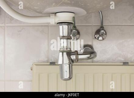 Basin siphon or sink drain in a bathroom, dirty - Stock Photo