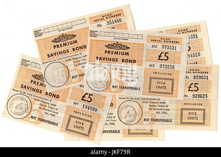 Pile of £5 premium savings bond certificates. - Stock Photo