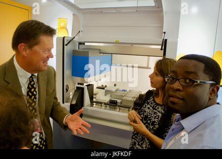 Paris, France, IAS, International AIDS Society Meeting, Trade Show,, Businessman, talking about HIV, testing equipment - Stock Photo