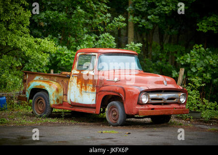 Rusty classic american cars in a junkyard near kingman for American restoration cars for sale