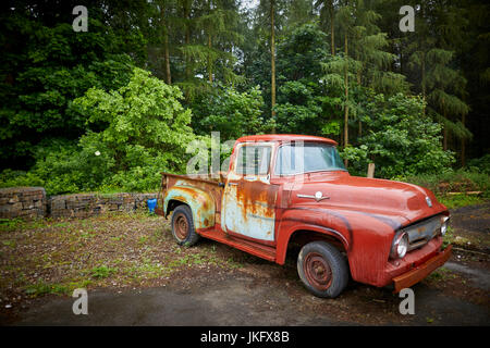 A rusty old car kept in a barn stock photo royalty free for American restoration cars for sale