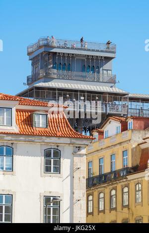 Lisbon Elevador de Santa Justa, view of the top of the Elevador de Santa Justa rising above the roofs of the Baixa - Stock Photo