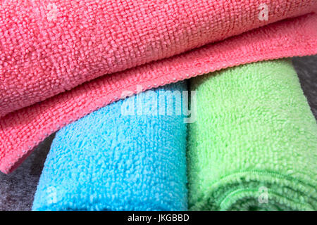 Pink, Blue and Green Microfibre Cleaning Cloths rolled up. Generally used for Household Chores and Cleaning - Stock Photo