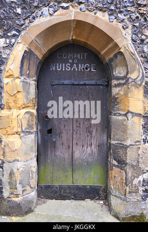 Small Door With Commit No Nuisance Sign, The Clock Tower, Market Place, St Albans, Hertfordshire, UK - Stock Photo