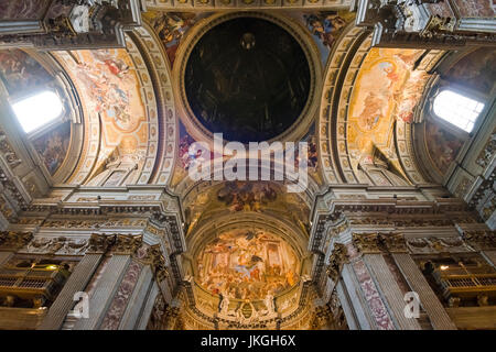 Horizontal view of the painted ceiling and dome inside Sant'Ignazio Church in Rome. - Stock Photo