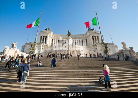 Horizontal view of people climbing the stairs at the Vittoriano or Victor Emanuele II monument in Rome. - Stock Photo