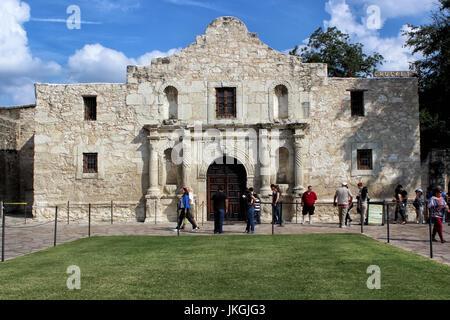 Tourists Visiting The Historic Alamo in San Antonio, Texas - Stock Photo