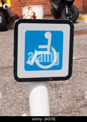 disabled parking sign on post a train station; Essex; UK - Stock Photo