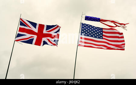 Union Jack flag and the stars and stripes of the USA flying together over Kingsley, near Bordon, Hampshire, UK. - Stock Photo