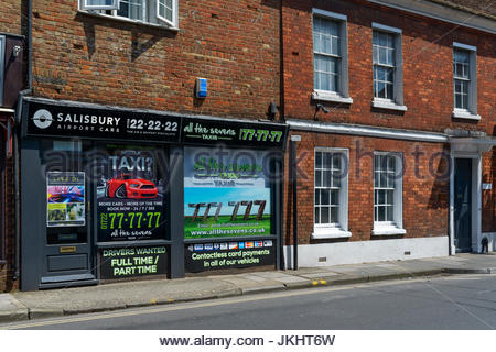 All the Sevens taxi office, Salisbury, Wiltshire, England UK - Stock Photo